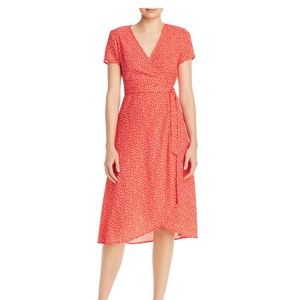 Red wrap dress by Charlie Hiliday. Size 4 or 36